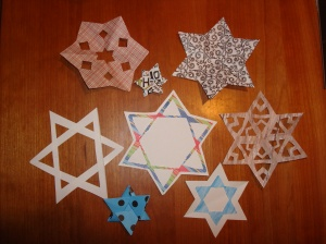 8 paper stars for the first 8 days of Chanukah