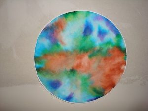 color coded elevation of Venus.  Red is high elevation, blue is low.  done on a coffee filter with water soluble markers