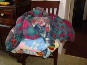 This is my pile of quilts that needs repairs.