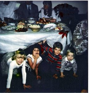 me, my cousins and sister coming out from under Great Grandma's table on Christmas Eve
