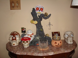 This  year's ancestor altar...paper skull on top of the tree is for holding letters.
