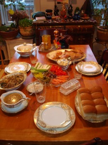 Our thanksgiving table (minus silverware and napkins).  Hope your day was as blessed as ours.