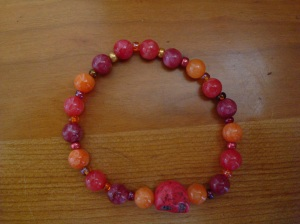 A brightly colored bracelet with colored skull to remind me to enjoy life.
